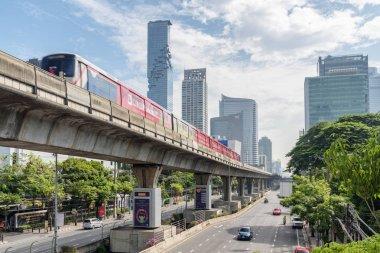 Skytrain passing above Sathon Road, Bangkok, Thailand