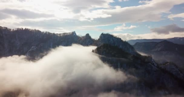 Amazing landscape and rugged mountains raise above the clouds and fog shortly before sunrise