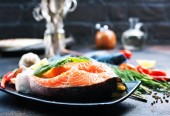 raw salmon steak with salt and ingredients