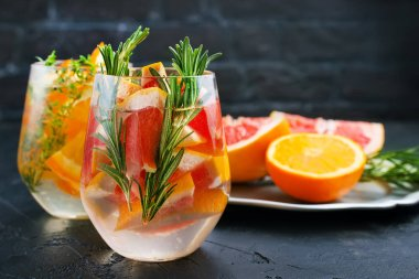 Grapefruit and rosemary gin cocktail, refreshing drink with ice.