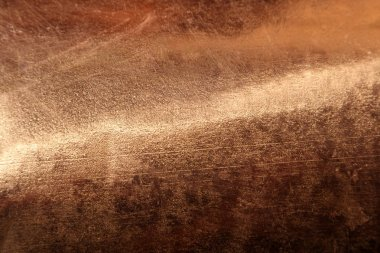 Scratched texture copper plating background close-up