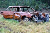 Burnt out car at side of road