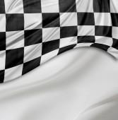 Fotografie Karierte rennflagge auf weiße seidige Zeitmessung schwarz-weiß