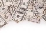 Closeup nejrůznějších amerických bankovek na jednoduché pozadí