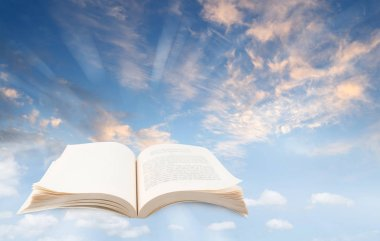 Open book in blue sky