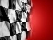 Fotografie Schwarze und weiße Zielflagge auf rotem Grund