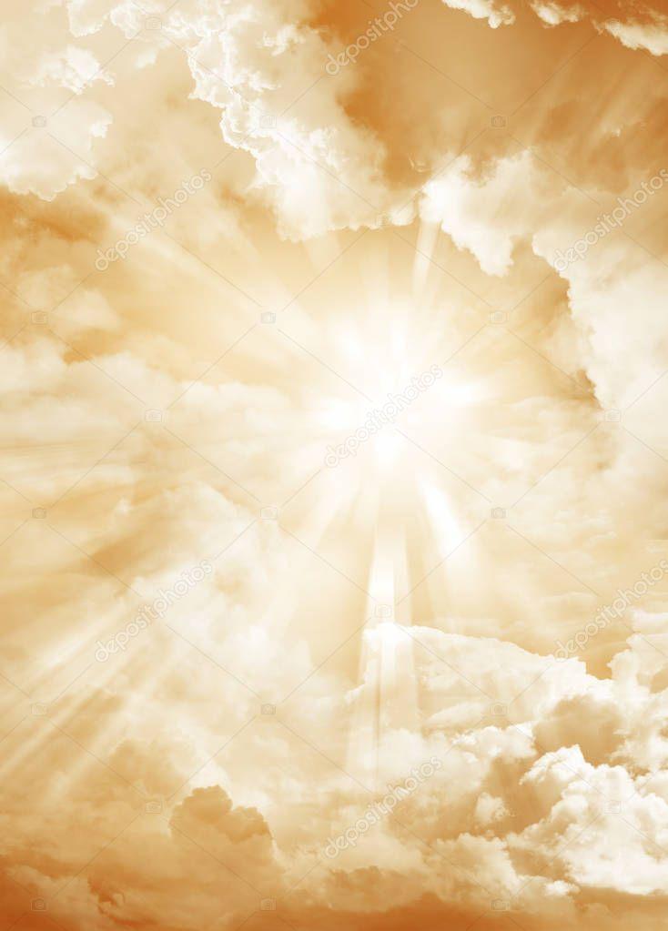 Sun rays in bright sky