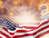 American flag in bright sky