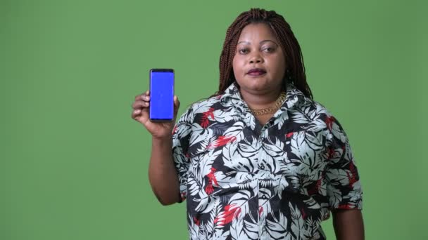 Overweight beautiful African woman against green background