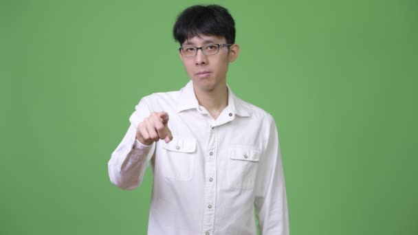 Young Asian businessman pointing to camera