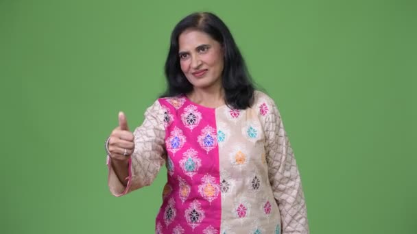 Mature beautiful Indian woman giving thumbs up