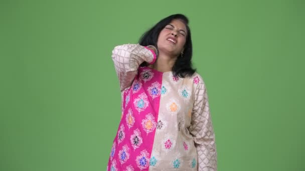 Mature stressed Indian woman having neck pain
