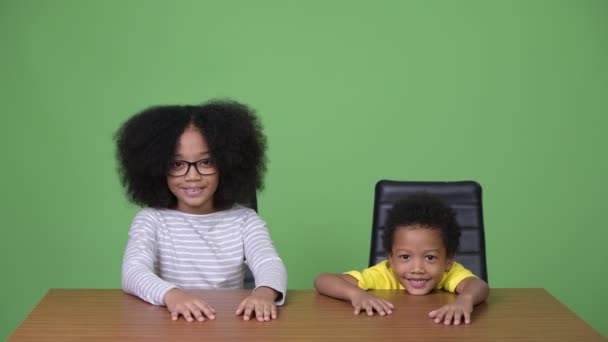 Young cute African siblings with Afro hair together