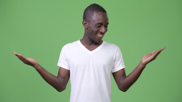 Young African man smiling while choosing between left and right