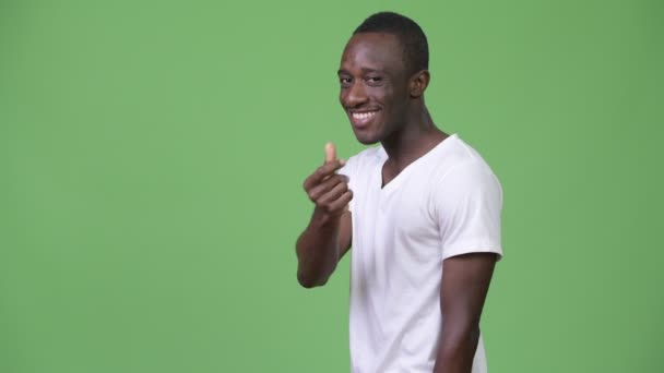 Young African man snapping fingers and showing something