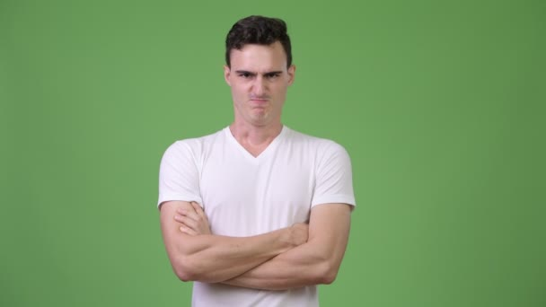 Young angry man with arms crossed