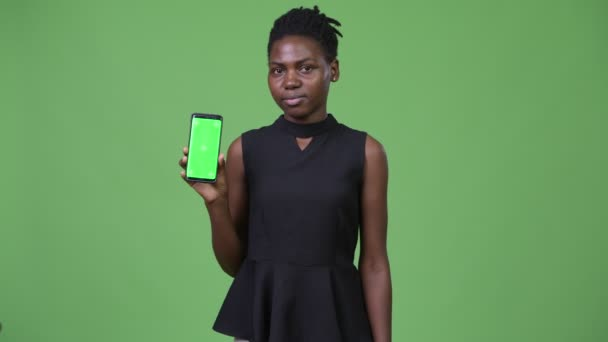 Young beautiful African businesswoman showing phone