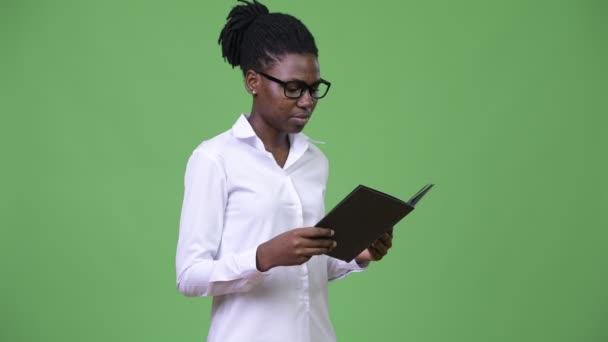 Young beautiful African businesswoman reading book