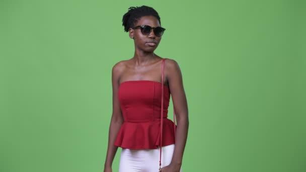 Young beautiful African woman wearing sunglasses