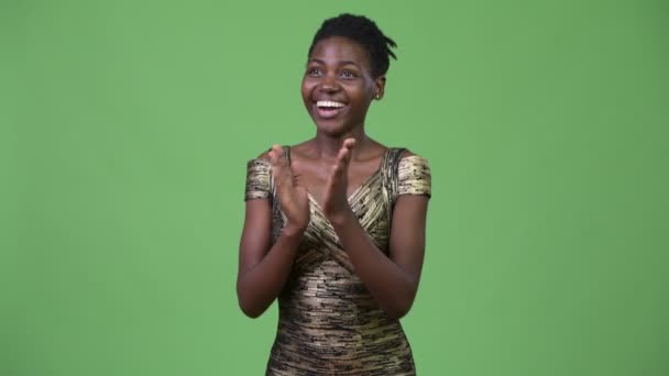Young beautiful African woman clapping hands
