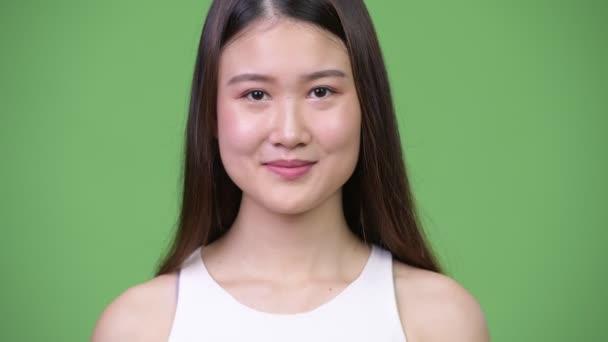 Young beautiful Asian businesswoman smiling