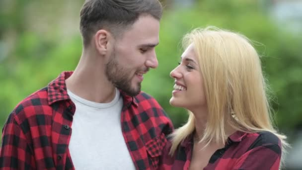 Young happy couple looking at each other in the streets outdoors