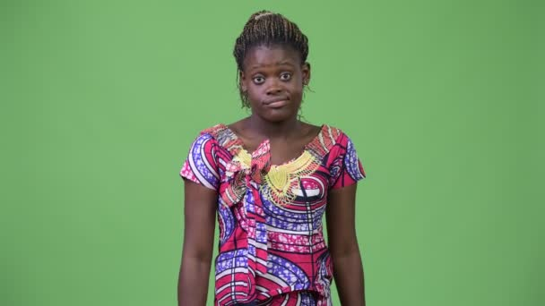 Young African woman shrugging shoulders