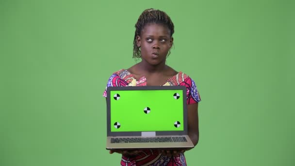 Young African woman showing laptop