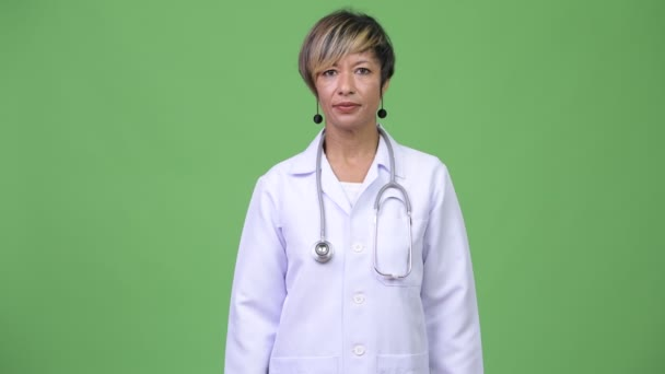 Happy mature beautiful multi-ethnic woman doctor