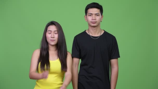 Young Asian couple with arms crossed together