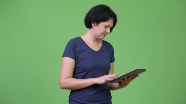 Beautiful woman with short hair using digital tablet