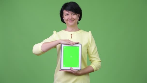 Beautiful businesswoman with short hair showing digital tablet