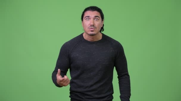 Angry man pointing and talking to camera