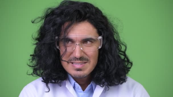 Crazy scientist wearing protective glasses planning something