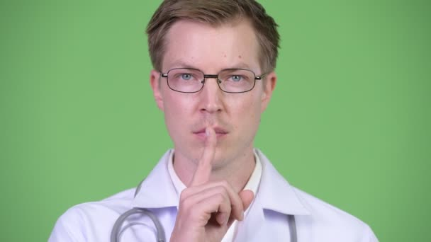 Man Doctor With Finger On Lips