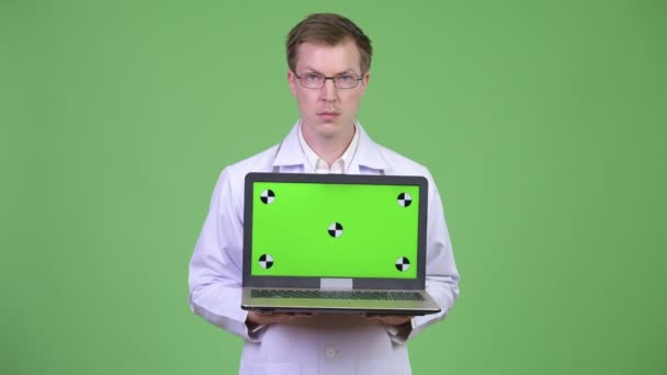 Happy Man Doctor Showing Chroma Key Green Screen Laptop Computer