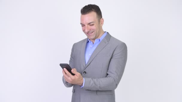 Happy Businessman Texting And Using Mobile Phone While Thinking