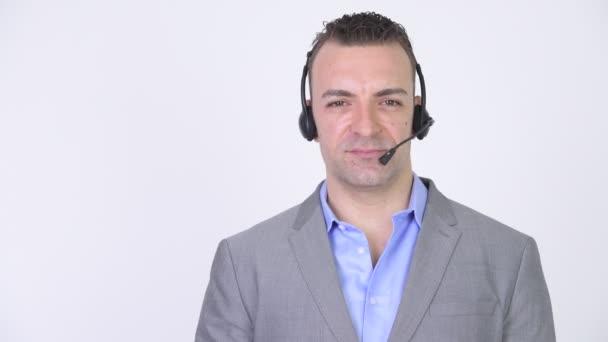 Šťastný podnikatel s Headset Call centra podpory komunikace