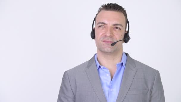 Šťastný podnikatel poslech sluchátek Call centra podpory komunikace