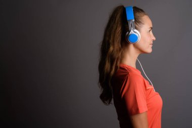 Young beautiful woman with long blond hair listening to music ag