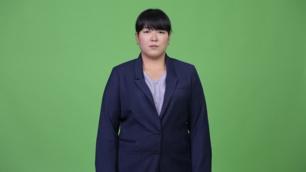 Krásné nadváhu asijské podnikatelka s úsměvem