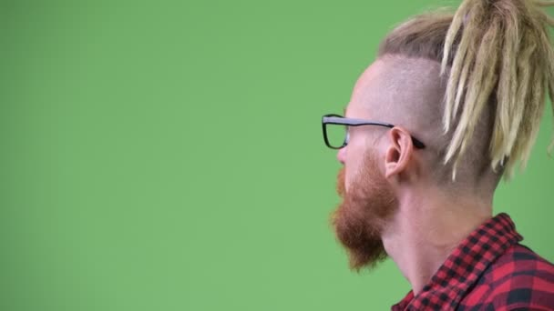 Profile view of handsome bearded hipster man with dreadlocks