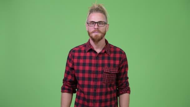 Happy handsome bearded hipster man with dreadlocks giving handshake