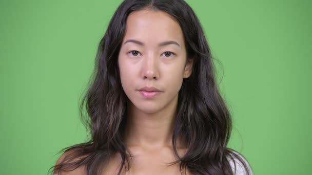 Head shot of young beautiful multi-ethnic woman