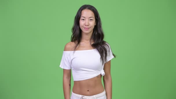 Studio shot of young beautiful multi-ethnic woman against chroma key with green background