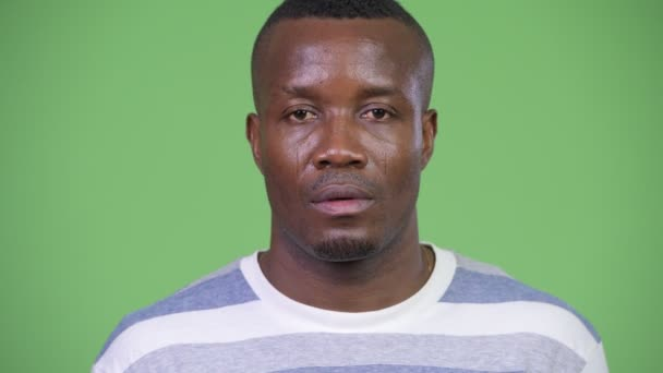 Young African man looking shocked