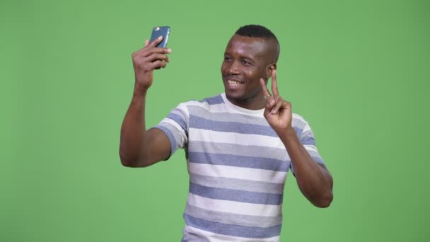 Young happy African man taking selfie