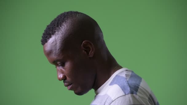 Head shot profile view of young African man looking up