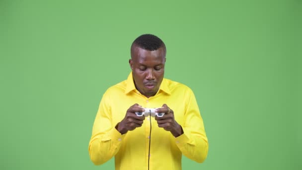 Young African businessman playing games