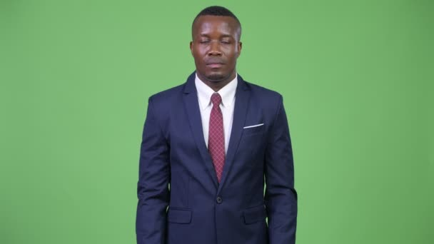 Young African businessman pointing to camera